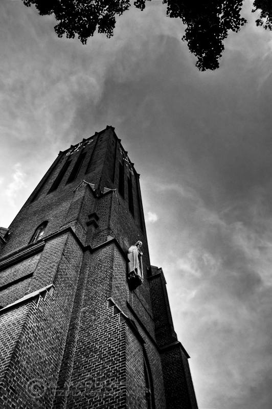 St. Mariä Empfängnis I - Black & White image of the tower of the St. Mariä Empfängnis church in Cologne, Germany, taken from the ground level, next to the base of the tower.